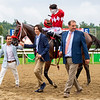 Nick Martinez, Andres Gutierrez and Fausto Gutierrez join Letruska with Irad Ortiz Jr. after win of the Personal Ensign Stakes (G1) at Saratoga Race Course in Saratoga Springs, N.Y., on Aug. 28, 2021.