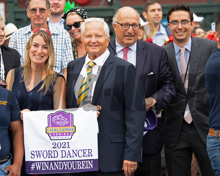 (L-R): Girl unknwon, Stephen Cainelli, co-breeder of Gufo, trainers Christophe and Miguel Clement. Photo: Anne M. Eberhardt