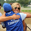 Assistant trainer Katie Tolbert hugging groom Darwin Aguilar after the 152nd Running of the Travers (GI) at Saratoga on August 28, 2021. Photo By: Chad B. Harmon