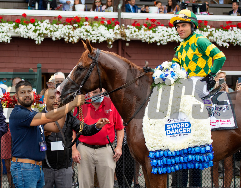 Winning connections in the winner's circle after Gufo with Joel Rosario win the Resorts World Casino Sword Dancer Stakes (G1T) at Saratoga Race Course in Saratoga Springs, N.Y., on Aug. 28, 2021.
