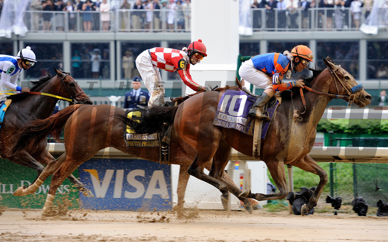Caption: Mona de Momma with Joel Rosario up wins the Humana Distaff (gr. I). Pretty Prolific with Robby Albarado up in second.<br /> Derby day at Churchill Downs near Louisville, Ky. on May 1, 2010.<br /> HumanaDistaff  image782<br /> Photo by Anne M. Eberhardt