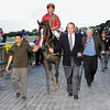 Art Preston leads his Jockey Club Gold Cup winner, Flat Out to the winner's circle.<br /> Coglianese Photos
