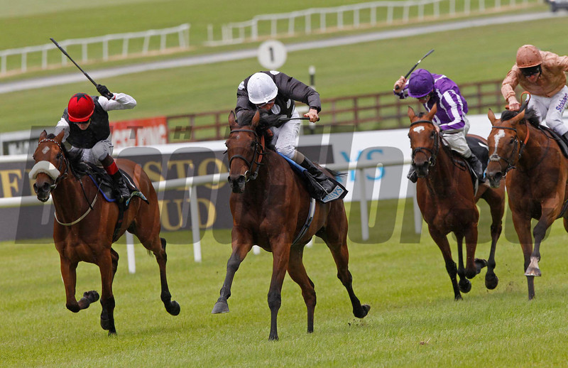 Racing from The Curragh 1/7/12. The Barclays Bank Pretty Polly Stks.<br /> Izzi Top (centre) ridden by William Buick wins from Sapphire (left) with I'm A Dreamer (right).
