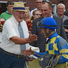Trainer H. Allan Jerkens gives jockey Junior Alvarado a playful tap on the cheek after he rode Emma's Encore to the win in The Prioress Stakes at the Saratoga Race Course in Saratoga Springs, N.Y. August 4, 2012.   <br /> Photo by Skip Dickstein