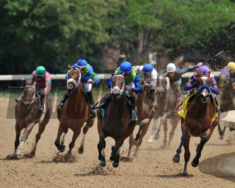 Juanita (center) charges ahead of Plum Pretty (right) in the final turn of the 27th Running of The La Troienne Stakes (g II).<br /> Photo by Courtney V. Bearse.