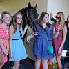 Caption: photo with the outrider pony is fun<br /> Scenes at Keeneland on Oct. 5, 2012.<br /> Keeneland<br /> Alcibiades2 image085<br /> Photo by Anne M. Eberhardt