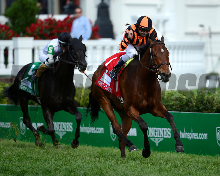 Little Mike ridden by Jo Bravo wins the 26th running of The Woodford Reserve Turf Classic GI at Churchill Downs May 5, 2012.<br /> Photo by Skip Dickstein.
