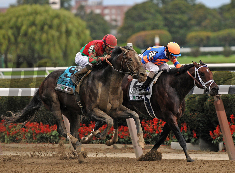 Flat Out, Joel Rosario up, hold off Stay Thirsy, to win the Gr1 Jockey Club Gold Cup for the second year in a row.<br /> Bill Mott trains the winner for Preston Farms...<br /> Time for the mile and a half race was, 2:01 44<br /> © 2012 Rick Samuels/The Blood-Horse