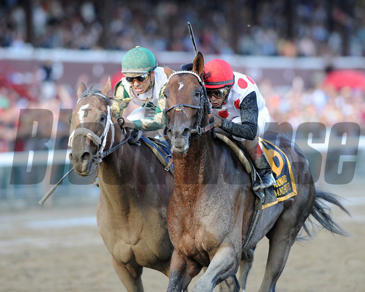 To Honor and Serve wins the 2012 Woodward Stakes.<br /> Photo by Coglianese Photos