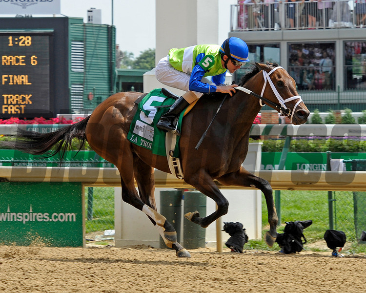 Caption:  Juanita with Ramon Dominguez wins the La Troienne (gr. II)<br /> Kentucky Derby and Kentucky Oaks contenders on the track at Churchill Downs near Louisville, Ky. on May 3, 2012.<br /> LaTroienne1  image357<br /> PHoto by Anne M. Eberhardt
