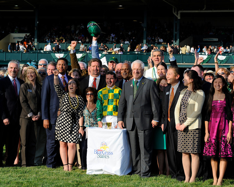 Trainer Dale Romans, left of jockey Kent Desormeaux, and Donegal Racing majority partner Jerry Crawford, right of Desormeaux, celebrate in winners circle. Toyota Blue Grass (gr. I)  on April 14, 2012, at Keeneland in Lexington, Ky.<br /> Photo by Anne M. Eberhardt