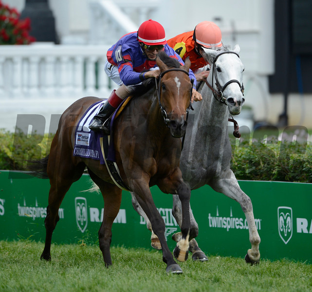 Hungrey Island with jockey John Velasquez up motors passed Tapitsfly with jockey Ramon Dominguez to win the 27th running of The Churchill Downs Turf Mile GII.  <br /> Photo by Skip Dickstein.