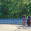 Kentucky Derby and Preakness winner I'll Have Another, and exercise rider Jonny Garcia, being led back to the barn Friday morning, by Lava Man and outrider Sabas Rivera...<br /> © 2012 Rick Samuels/The Blood-Horse