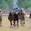 Juanita (center) Ramon Dominguez up, wins the La Troienne at Churchill Downs...<br /> St. Johns River (left) was second, Plum Pretty (purple cap) was third.<br /> © 2012 Rick Samuels/The Blood-Horse