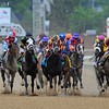 The start of the Kentucky Oaks...<br /> Eventual winner, Believe You Can, Rosie Napravnik up (orange and green cap)<br /> © 2012 Rick Samuels/The Blood-Horse