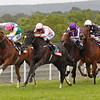 Goodwood 4/8/12. The Nassau Stakes.<br /> The Fugue ridden by Richard Hughes (pink) wins from Timepiece (left).