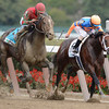 Jockey Ramon Dominguez loses his whip as #9 Flat Out with jockey Joel Rosario in the irons, left surges past to win the 94th running of The Jockey Club Gold Cup Invitational at Belmont Park in Elmont, N.Y. Sept. 29, 2012.     <br /> © 2012 Skip Dickstein