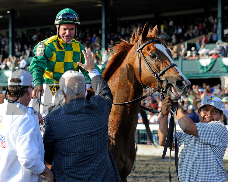 Caption:  Owner Jerry Crawford of Donegal Racing high fives Kent Desormeaux<br />  Dullahan with Kent Desormeaux up wins the Toyota Blue Grass (gr. I)  on April 14, 2012, at Keeneland in Lexington, Ky.<br /> Photo by Anne M. Eberhardt