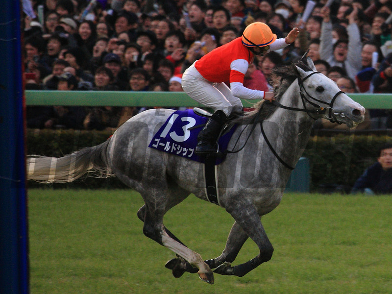 Gold Ship, with Hiroyuki Uchida in the irons, wins the Arima Kinen. Photo by Naoji Inada