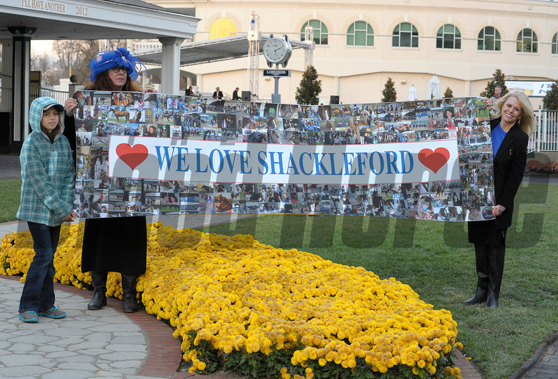 Caption:Shackleford fans with sign in paddock<br /> Shackelford wins the Clark Handicap at Churchill Downs on Nov. 23, 2012, in Louisville, Ky.<br /> Clark Origs 1 image434<br /> Photo by Anne M. Eberhardt