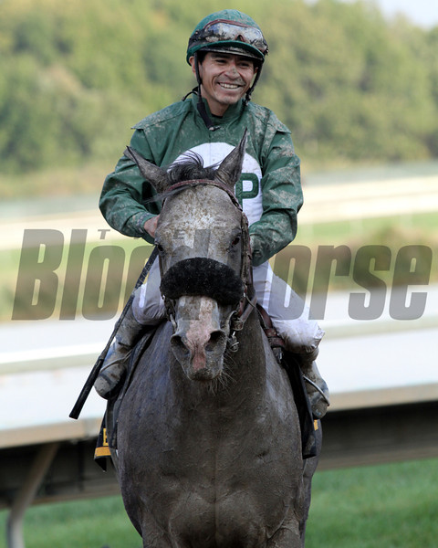 Pablo Fragoso is all smiles after winning the 22nd Running of the Gallant Bob aboard Well Spelled at Parx on September 22, 2012.<br /> Photo by Chad B. Harmon