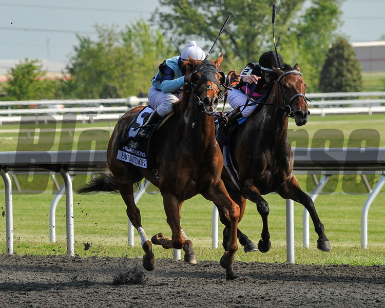 Pachattack (outside) and Kathmanblu enter a duel in the stretch for the Hilliard Lyons Doubledogdare (GIII) at Keeneland April 20th. Pachattack pulled away victorious, giving the win to trainer Graham Motion and owner Flaxman Holdings, LLC.<br /> Photo by Mallory Haigh