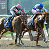 Shackleford, right ridden by jockey John Velazquez withstood the challenge of Caleb's Posse with jockey Rajiv Maragh to win the $750,000 Metropolitan Handicap at Belmont Park in Elmont, N.Y. May 28, 23012.  (Skip Dickstein Photo)