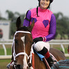 12/14/2013  -  Jockey Rosie Napravnik aboard Ladyzarbridge flashes a smile after winning the Louisiana Champions Day Ladies at Fair Grounds.  Hodges Photography / Lynn Roberts