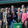 Caption: Trophy pres includes owner Ian Banwell behind jockey Nakatani.<br /> Last Full Measure with Corey Nakatani wins the Madison.<br /> Keeneland racing scenes during April 13,  2013, at Keeneland in Lexington, Ky.<br /> JennyWileyANDMadison1  image504<br /> Photo by Anne M. Eberhardt