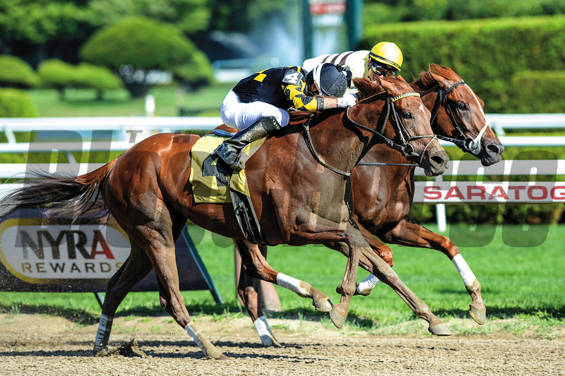 Dance to Bristol and jockey Xavier Perez go head to head with Classic Point to win the Grade II Honorable Miss Handicap at Saratoga.<br /> Photo by: Adam Coglianese/NYRA