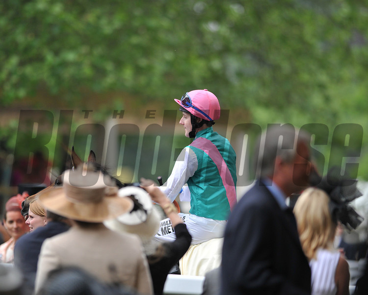 returning to winners enclosure Royal Ascot; UK, photo by Mathea Kelley, Jockey Tom Quelley