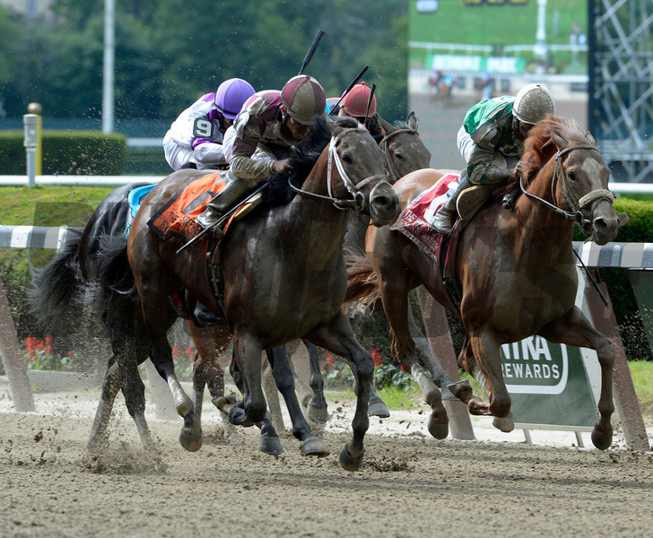 Forty Tales, left ridden by Joel Rosario comes flying on the outside to win the 29th running of The Woody Stephens at Belmont Park June 8, 2013.  Photo by Skip Dickstein