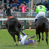 Jockey Emilio Flores looses an iron on his mount Yougotthatgoinforu and is unseated May 18, 2013 during the 4th running of the James W. Murphy S.Stakes at Pimlico Race Course in Baltimore, Maryland.  Photo by Skip Dickstein
