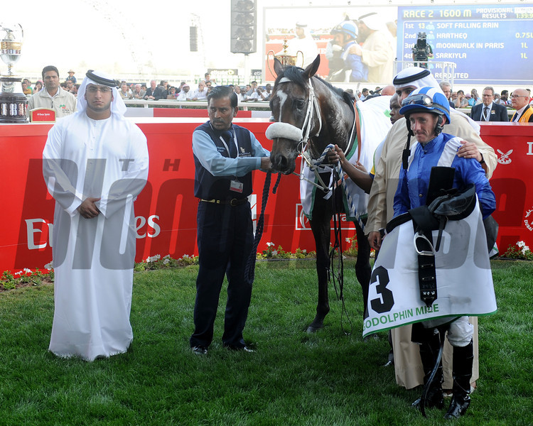 Soft Falling Rain in the winner's circle after a victory in the Godolphin Mile.<br /> Photo by Dave Harmon