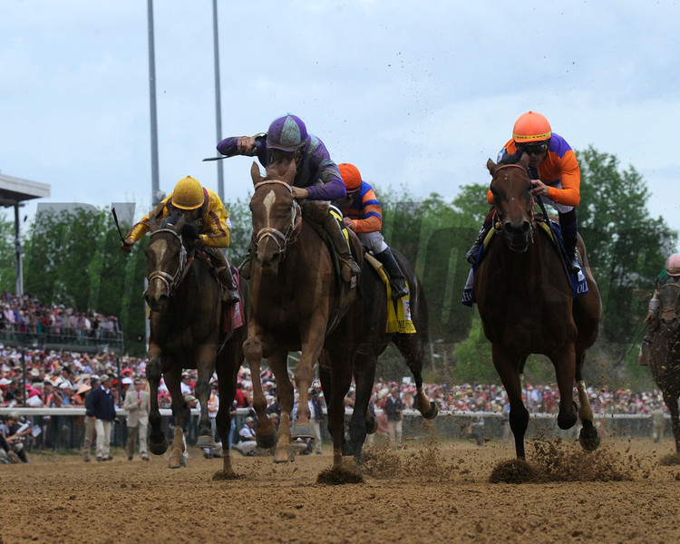 Princess of Sylmar with jockey Mike Smith wins the 139th running of the Kentucky Oaks May 3, 2013.  Photo by Skip Dickstein