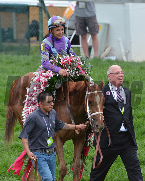 Jockey Mike Smith and Ed Stanco walk Princess Of Sylmar into the winners circle after the 2013 Kentucky Oaks.<br /> ©Courtney V. Bearse Photo