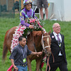 Jockey Mike Smith and Ed Stanco walk Princess Of Sylmar into the winners circle after the 2013 Kentucky Oaks.<br /> ©Courtney V. Bearse Photo
