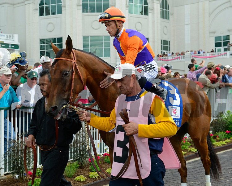 Caption:  in the paddock Gomez pats on Beholder<br /> Princess of Sylmar with Mike Smith wins the Kentucky Oaks sponsored by Longines at Churchill Downs near Louisville, Ky. on May 3, 2013, during Kentucky Derby and Kentucky Oaks week.<br /> 11Oaks2  image717<br /> Photo by Anne M. Eberhardt