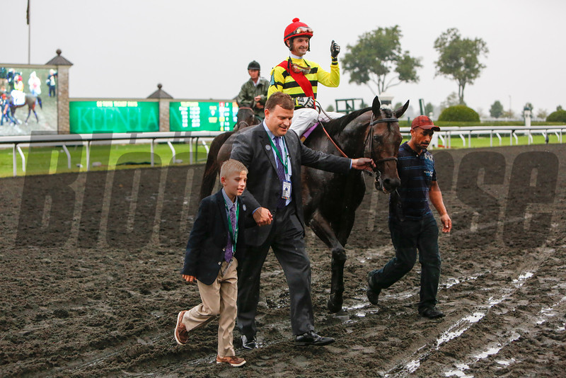 Max Bacon, far left for whom the horse is named, walks with his dad Mark Bacon in to the winners circle with Silver Max with Robby Albarado up wins the 28th Running of The Shadwell Turf Mile that was run on the poly track due to rain at Keeneland on October 5, 2013 in Lexington, Ky.<br /> Mark Mahan Photo