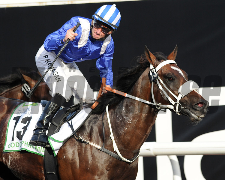 Soft Falling Rain wins the 2013 Godolphin Mile.<br /> Mathea Kelley Photo