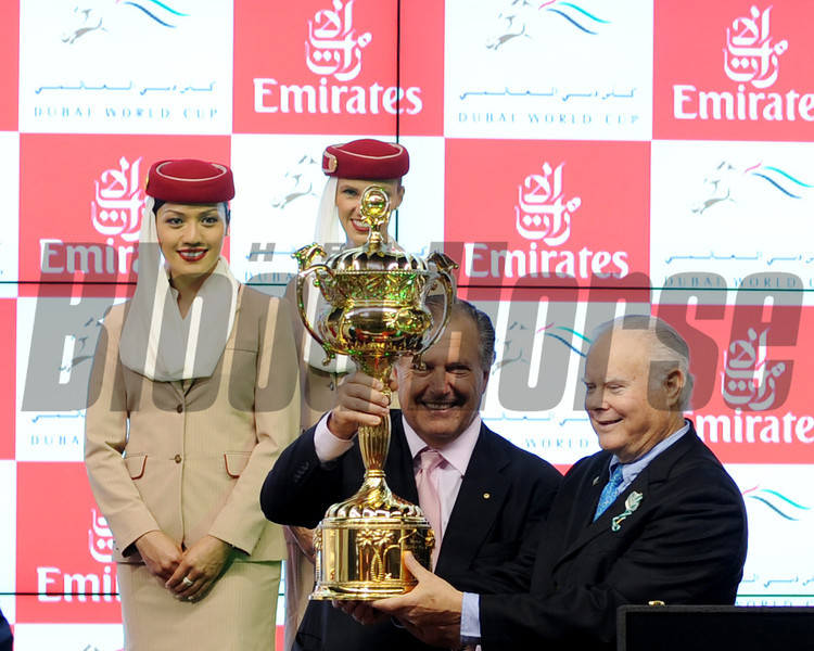 The majority partners for Animal Kingdom hold the Dubai World Cup trophy.<br /> Photo by Dave Harmon