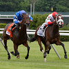 Stephanie's Kitten ridden  by John R. Velazquez, right holds off Better Lucky with jockey Joel Rosario to win the 20th running of The Longines Just A Game Stakes at the B Belmont Race Course in Elmont, N.Y. June 8, 2013.  Photo by Skip Dickstein
