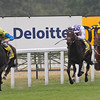 Racing from Ascot 27/7/13. King George  and Queen Elizabeth Stks. <br /> Novellist ridden by Johnny Murtagh wins from Trading Leather andUniversal (right)<br /> Trevor Jones Photo