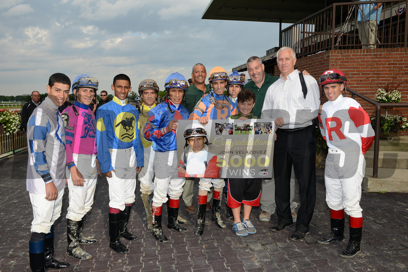 Jockey John Velazquez is congratulated on his 5,000th win at Belmont Park.