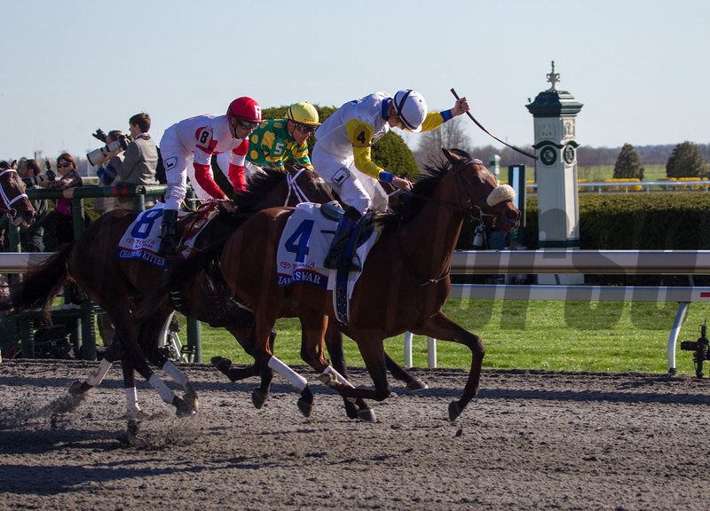 Java's War with Julien Leparoux (#4 outside) celebrates winning the 89th Running of The Toyota Blue Grass (Grade I) at Keeneland on April 13, 2013.  Photo by Mark Mahan
