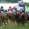 Jockey Emilio Flores looses an iron on his mount Yougotthatgoinforu and is unseated May 18, 2013 during the 4th running of the James W. Murphy S. Stakes at Pimlico Race Course in Baltimore, Maryland.  Photo by Skip Dickstein