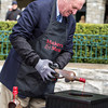 UK basketball great and James Naismith Memorial Basketball Hall of Famer Dan Issel dips the 2013 Maker's Mark Mile Trophy into the wax at Keeneland.<br /> Photo by: Kevin Thompson