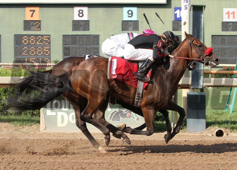 8/3/2013  -  Holiday Mischief and jockey M. Berry overtakes Sunbean with Corey Lanerie aboard at the wire to win the 30th running of the $100,000 Super Derby Prelude at Louisiana Downs.  Hodges Photography / Lou Hodges, Jr.