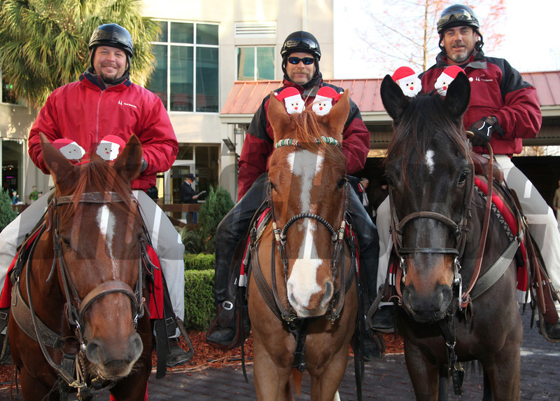 12/23/2013  -  Fair Grounds outriders (l-r) Pete Love, Darrin Cain & Robert Meyer get into the Christmas spirit decorating their horses with Santa Claus head bands, for the running of the Santa Claus Classic at Fair Grounds.  Hodges Photography / Alexander Barkoff.