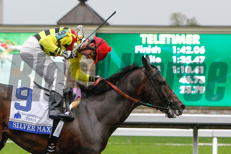 Robby Albarado celebrates as Silver Max wins the 28th Running of The Shadwell Turf Mile that was run on the poly track due to rain at Keeneland on October 5, 2013 in Lexington, Ky.<br /> Mark Mahan Photo